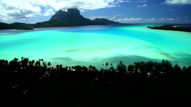aerial of turquoise lagoon coral reef south pacific - bora bora aerial stock videos and b-roll footage