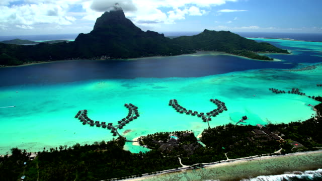 aerial of turquoise lagoon coral reef south pacific - tahiti video stock e b–roll