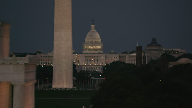 aerial of united states capitol building, washington d.c., evening sunset - washington monument washington dc stock videos & royalty-free footage