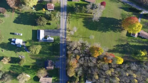 aerial of village country scene during a beautiful autumn afternoon - rural scene stock videos & royalty-free footage