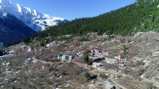 Aerial of village in Kinnaur India with the Himalayas mountain range in the background