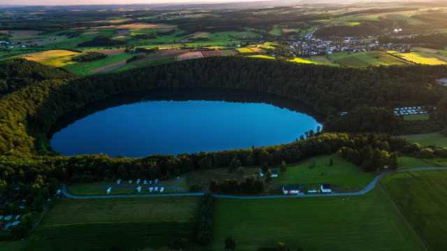 aerial of volcanic maar pulvermaar in germany - patchwork landscape stock videos and b-roll footage