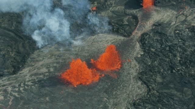 Aerial of volcanic magma destroying landscape Kilauea Hawaii