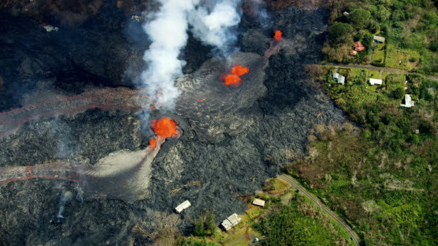 aerial of volcanic magma destroying landscape kilauea hawaii - volcano stock videos & royalty-free footage