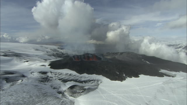 aerial of volcano erupting, lava spurting, eyjafjallajokull, iceland, april 2010 - 2010 stock videos and b-roll footage