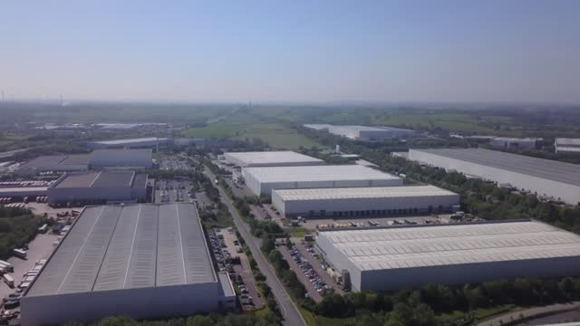 aerial of warehouses on northamptonshire used by businesses and online retailers - b roll stock videos & royalty-free footage