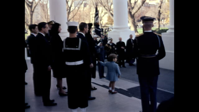 aerial of washington closing in on white house with american flag at halfstaff / military men drive empty horse drawn caisson to white house front... - john f. kennedy politik stock-videos und b-roll-filmmaterial