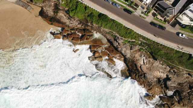 aerial of waves in bronte beach, sydney, new south wales, australia, pacific - coastal feature stock videos & royalty-free footage