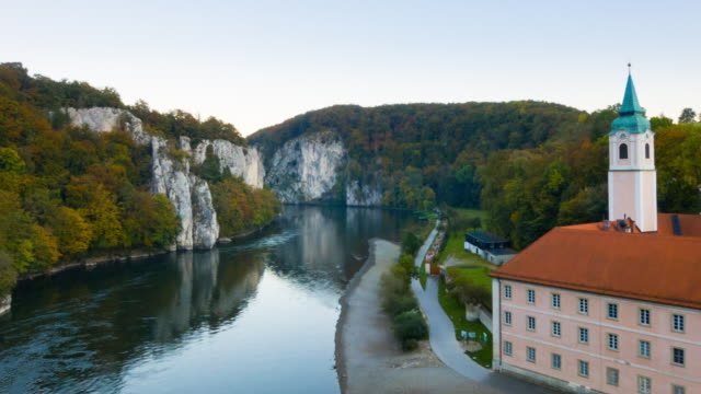ws aerial of weltenburg monastery and danube river - river danube video stock e b–roll