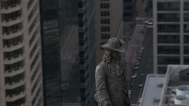 aerial of william penn statue atop philadelphia's city hall. - william penn stock videos and b-roll footage