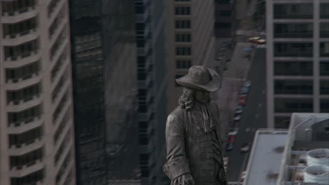 Aerial of William Penn statue atop Philadelphia's city hall.