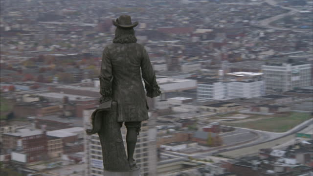 aerial of william penn's statue atop philadelphia's city hall. - william penn stock videos and b-roll footage