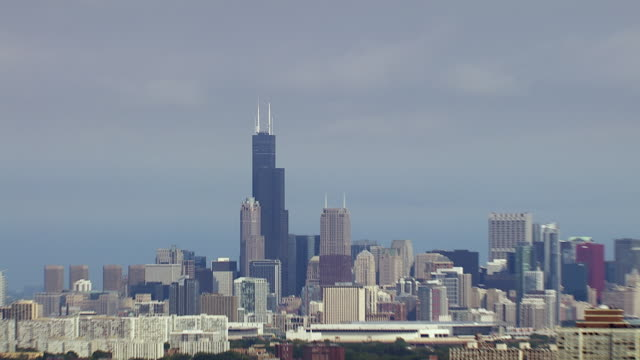 aerial of willis tower in chicago illinois - willis tower stock videos and b-roll footage