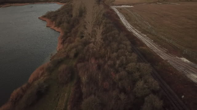 aerial of woodland at calvert jubilee nature reserve in buckinghamshire that will have to be cleared to make way for the hs2 high speed rail link - national park stock videos & royalty-free footage