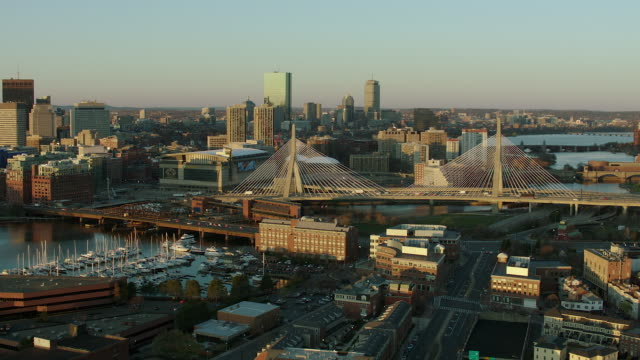 aerial of zakim bridge and boston skyscrapers - stadtzentrum stock-videos und b-roll-filmmaterial