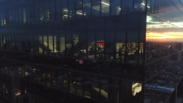 aerial office building at night - bank financial building stock videos and b-roll footage