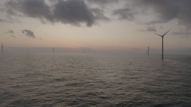 aerial offshore wind farm at sunset - propeller stock videos & royalty-free footage