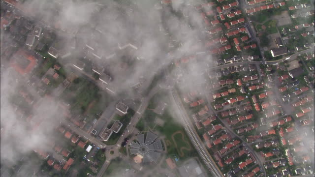 aerial oh ws suburbs and houses below overhead clouds / metz, lorraine, france - metz stock videos & royalty-free footage