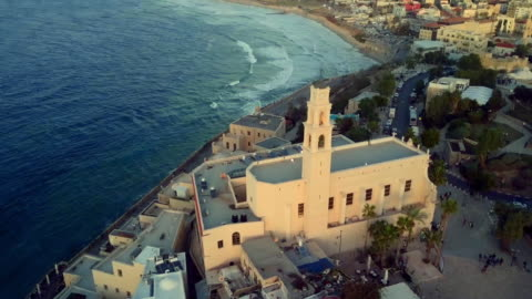 aerial: old and new city by scenic bay, jaffa, israel - ジャファ点の映像素材/bロール