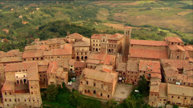 aerial old hilltop town overlooking valley / montepulciano, italy - montepulciano stock videos & royalty-free footage