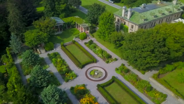 stockvideo's en b-roll-footage met aerial: opulent garden and mansion harkness memorial state park - landhuis