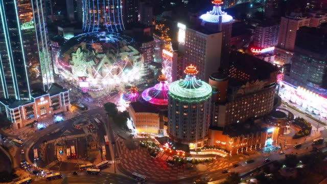 aerial or drone point of view of macau at night time, travel destination concept - macao stock videos & royalty-free footage