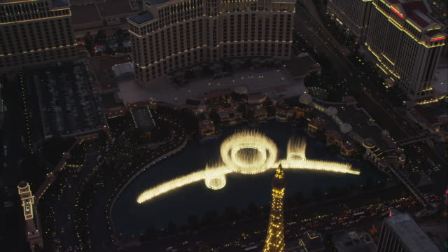 aerial orbit bellagio water fountain - fountain stock videos & royalty-free footage