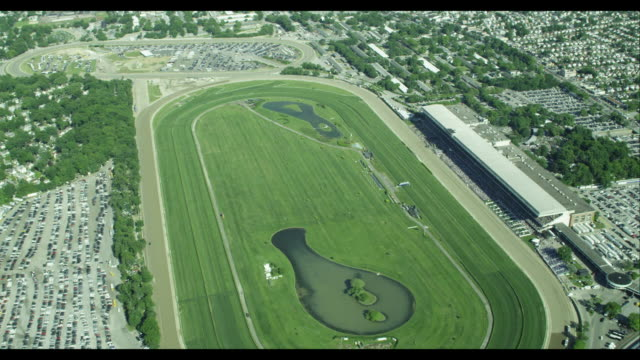 aerial orbit belmont racetrack - horse racing stock videos and b-roll footage
