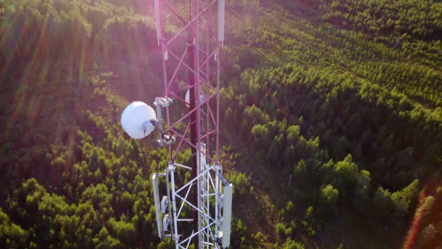 aerial orbit of mobile phone communication tower - tower stock videos & royalty-free footage