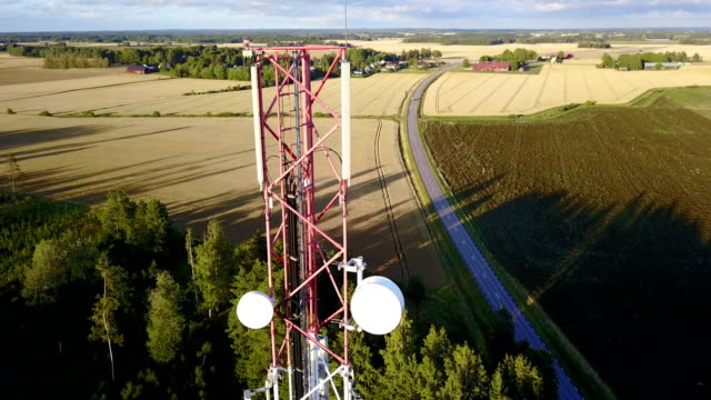 aerial orbit of mobile phone communication tower - telecommunications equipment stock videos and b-roll footage
