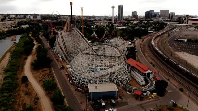 Aerial orbiting view of a roller coaster in action in Denver Colorado