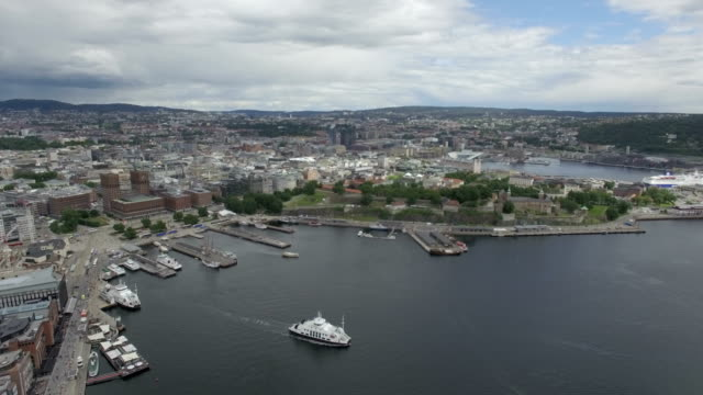 Aerial / Oslo city centre: Akershus Fortress, Oslo Opera House, Oslo fjord and port, Norway