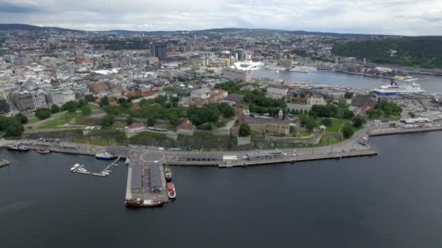 aerial / oslo city centre: akershus fortress, oslo opera house, oslo fjord and port - schlossgebäude stock-videos und b-roll-filmmaterial