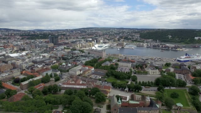Aerial / Oslo city centre: Akershus Fortress, Oslo Opera House, Oslo fjord and port