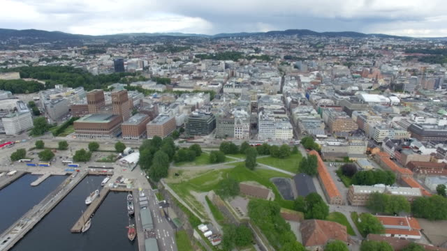 Aerial / Oslo city centre: City Hall, Nobel Peace Centre, and public houses