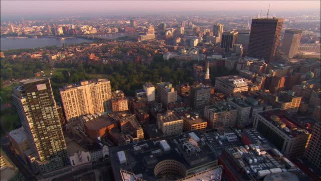 Aerial over 1 Financial Center and 1 Lincoln Street and Boston Common towards Longfellow Bridge / Boston, Massachusetts