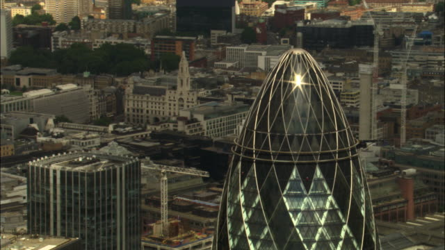 aerial over 30 st mary axe and tower 42 skyscrapers in city of london, 2007, london, uk - sir norman foster building stock videos & royalty-free footage