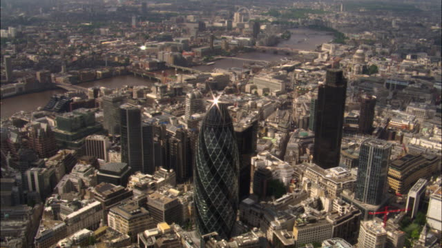 Aerial over 30 St Mary Axe and Tower 42 skyscrapers in City of London, 2007, London, UK