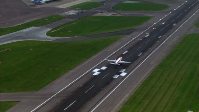aerial over aeroplane landing on northern runway, heathrow airport, london - heathrow airport stock videos and b-roll footage