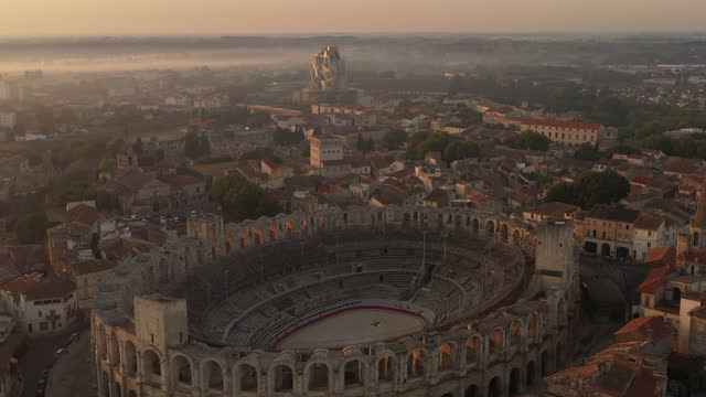 aerial over arles, france at sunrise, the camera moves left over the arles amphitheatre. - amphitheatre stock videos & royalty-free footage