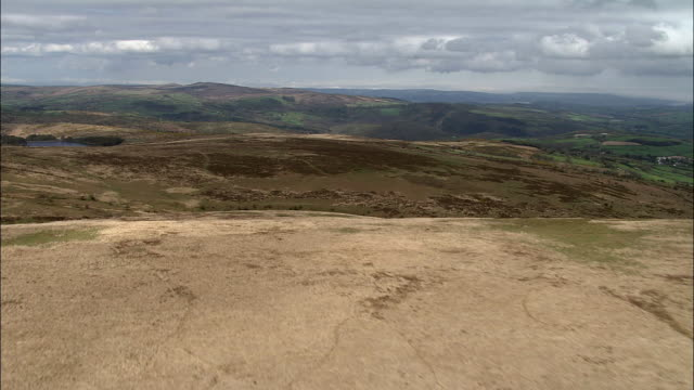 Aerial over barren moorland, Dartmoor, UK