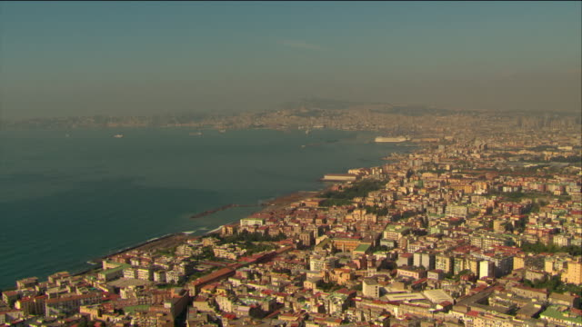 aerial over bay of naples and buildings on coast of naples / italy - ナポリ点の映像素材/bロール