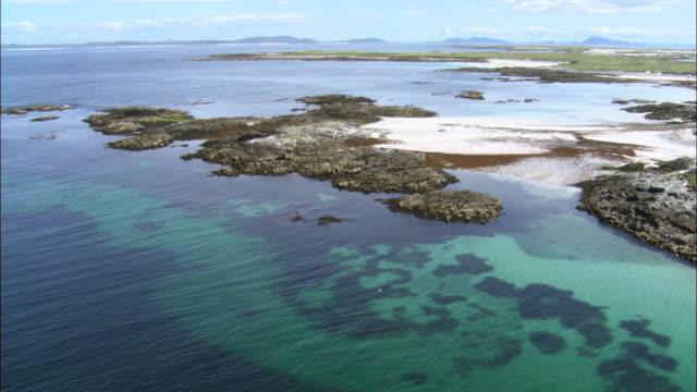Aerial over beach and coast of Monach Islands, Scotland, UK