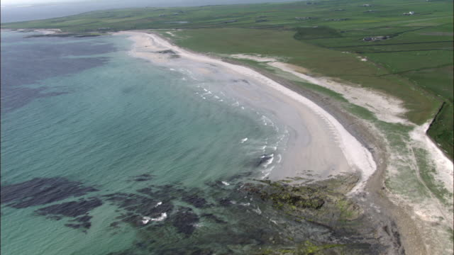 aerial over beach and coast on north ronaldsay, orkney, scotland - coastline stock videos & royalty-free footage