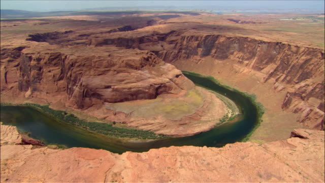 Aerial over bend in Colorado River Canyon / Page, Arizona