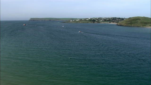aerial over boats in camel estuary, cornwall, uk - estuary stock videos & royalty-free footage