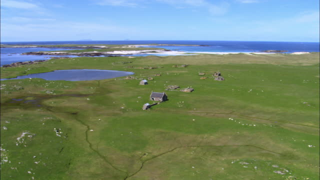 aerial over buiding and ruins on monach islands, scotland, uk - sunny stock videos & royalty-free footage