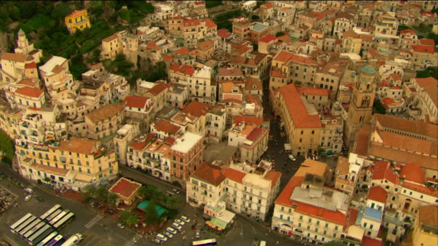 Aerial over buildings and cathedral with bell tower / Amalfi, Italy
