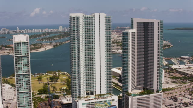 Aerial over buildings in downtown Miami sunny beautiful day FL