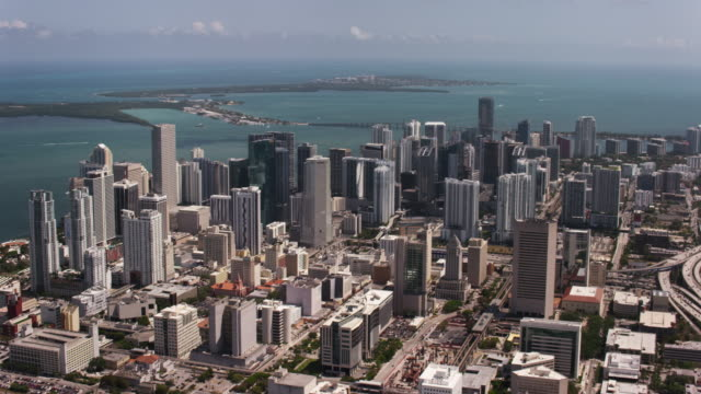 Aerial over buildings in downtown Miami sunny beautiful day